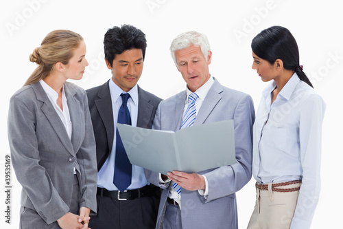 Boss talking about a file to his employees