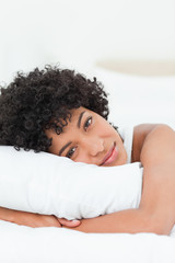 Portrait of a cute woman hugging her pillow