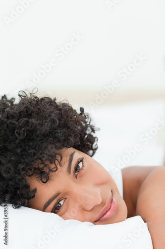 Portrait of a beautiful woman lying on her bed