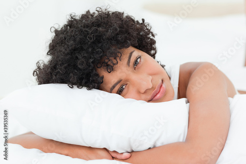 Portrait of a beautiful woman hugging her pillow