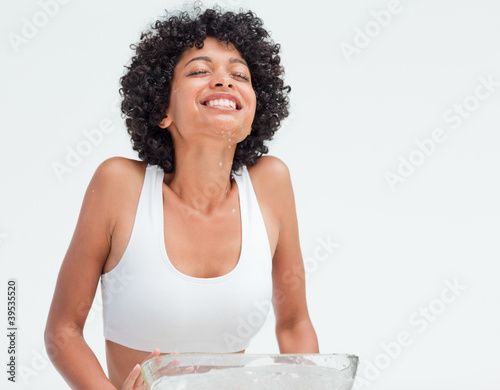 woman refreshing her face