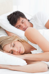 Close up, man and woman sleeping in bed