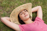 Young relaxed girl placing her hands behind her head while napping