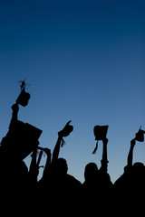 Young graduating students celebrating their new graduation