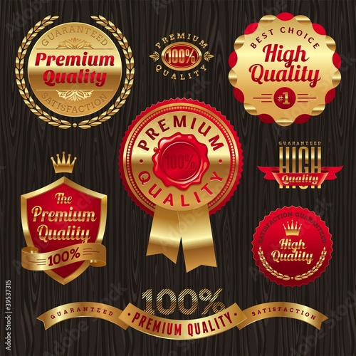 Set of golden quality labels and emblems