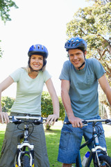 Couple looking at the camera while on their bikes