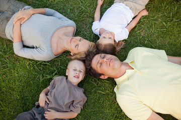 Family lying on the ground sleeping
