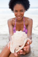 Beautiful shell being held by a young attractive woman