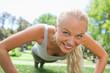 Sportswoman doing push ups
