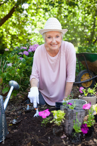 Woman smiling happily while gardening