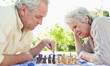 Man and a woman playing chess