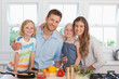 A happy family in the kitchen ready to make dinner