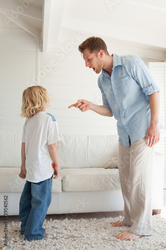 Father giving out to his son