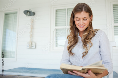 Woman reading a book outside