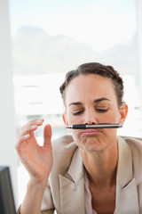 Businesswoman playing with her pen