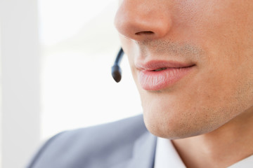 Close-up of a man's mouth talking with a headset