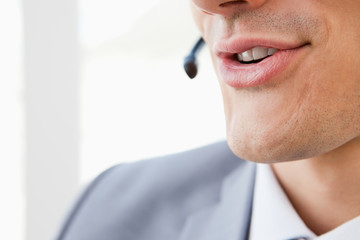Close-up of a man's mouth speaking with a headset