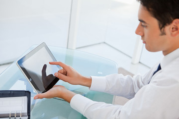 Businessman using a touch pad