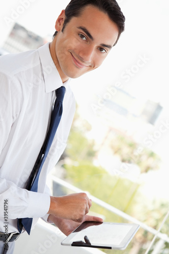 Portrait of a businessman using a touch pad
