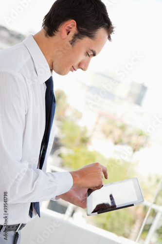 Businessman smiling while using a touch pad
