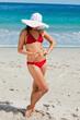Attractive woman in bikini holding a starfish