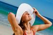 Attractive woman in bikini taking sunbathing