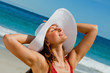 Attractive woman with a hat enjoying the sun