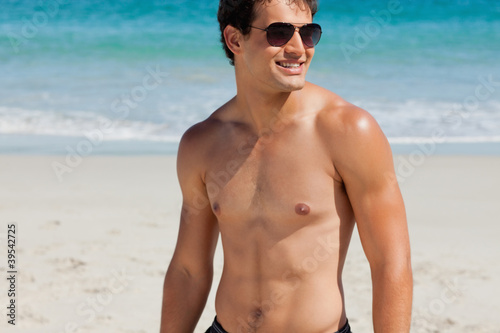 Close-up of an attractive tanned man with sunglasses