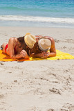 Couple being tanning on the beach