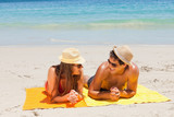 Couple being tanning while talking
