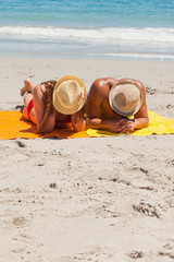 Couple being tanning