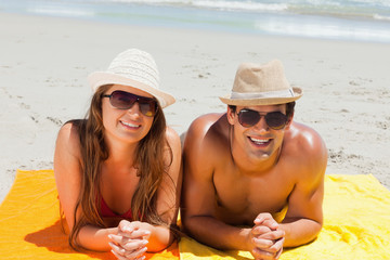 Portrait of a smiling couple being tanning