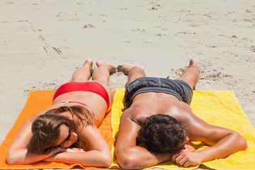 High angle-shot of a tanned couple sleeping