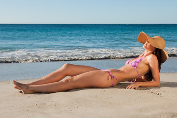 Gorgeous female lying on the sand