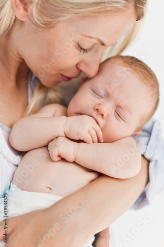 Close up of mother holding her sleeping baby