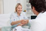 Happy woman shaking her doctors hand