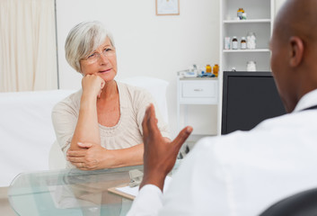 Mature woman listening to her doctor