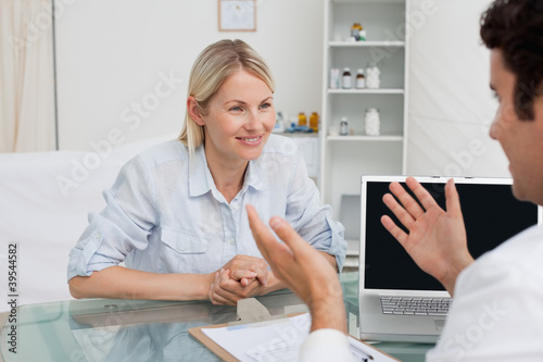 Cheerful woman seeing her doctor