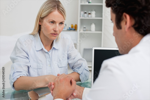 Worried woman seeing her doctor
