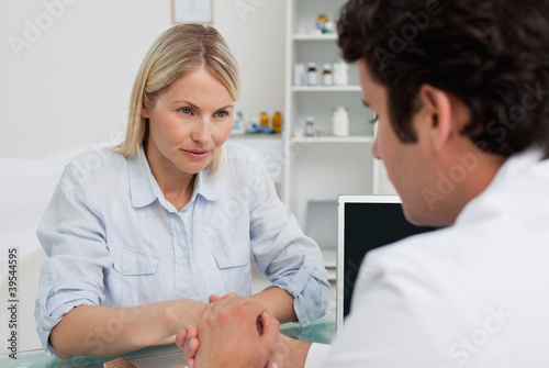 Woman listening closely to doctor