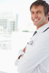 Side view of a doctor smiling while looking at the camera