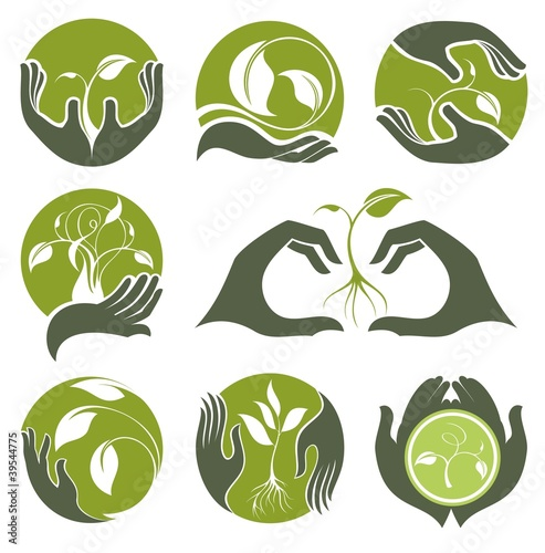 Set of symbols of human's hands and growing plants