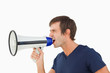 Side view of a furious man shouting through a megaphone
