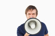Furious man using a megaphone to talk