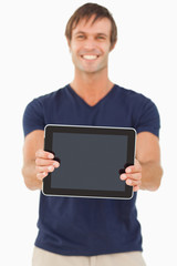 Tablet pc being held by a smiling man