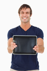 Tablet computer held by a young man