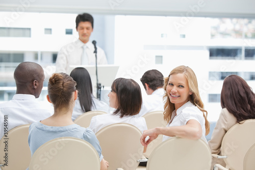 Woman looking behind he during a speech