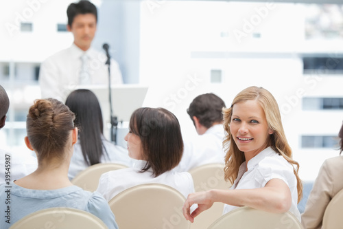 Smiling woman looking behind her during a presentation