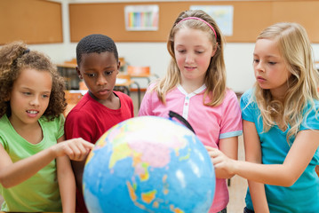 Students exploring globe