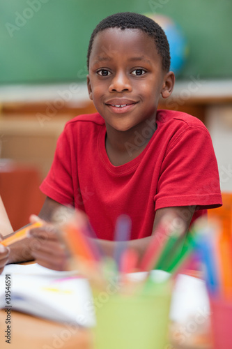 Smiling student sitting at desk during class